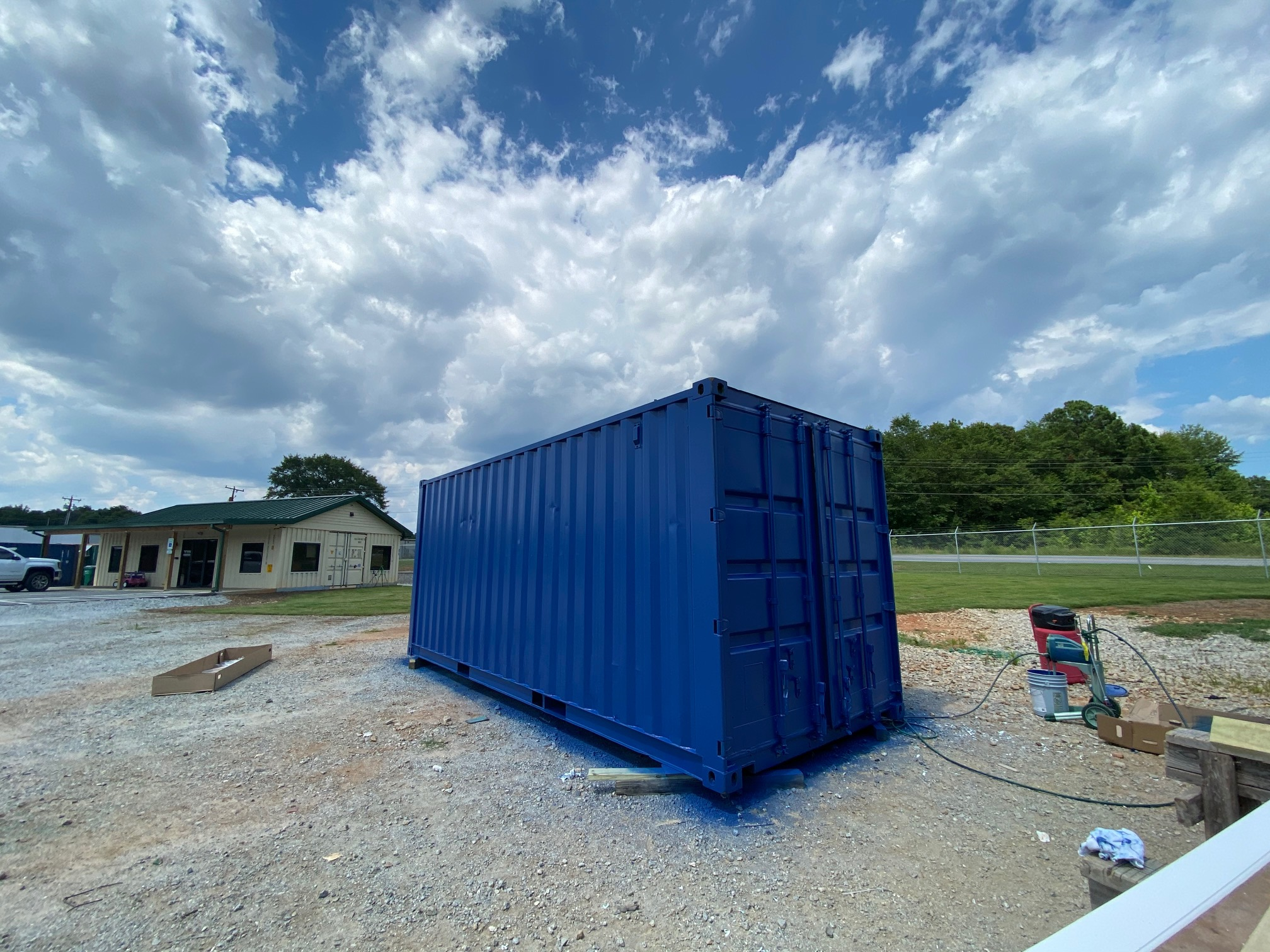 Blue storage container being painted