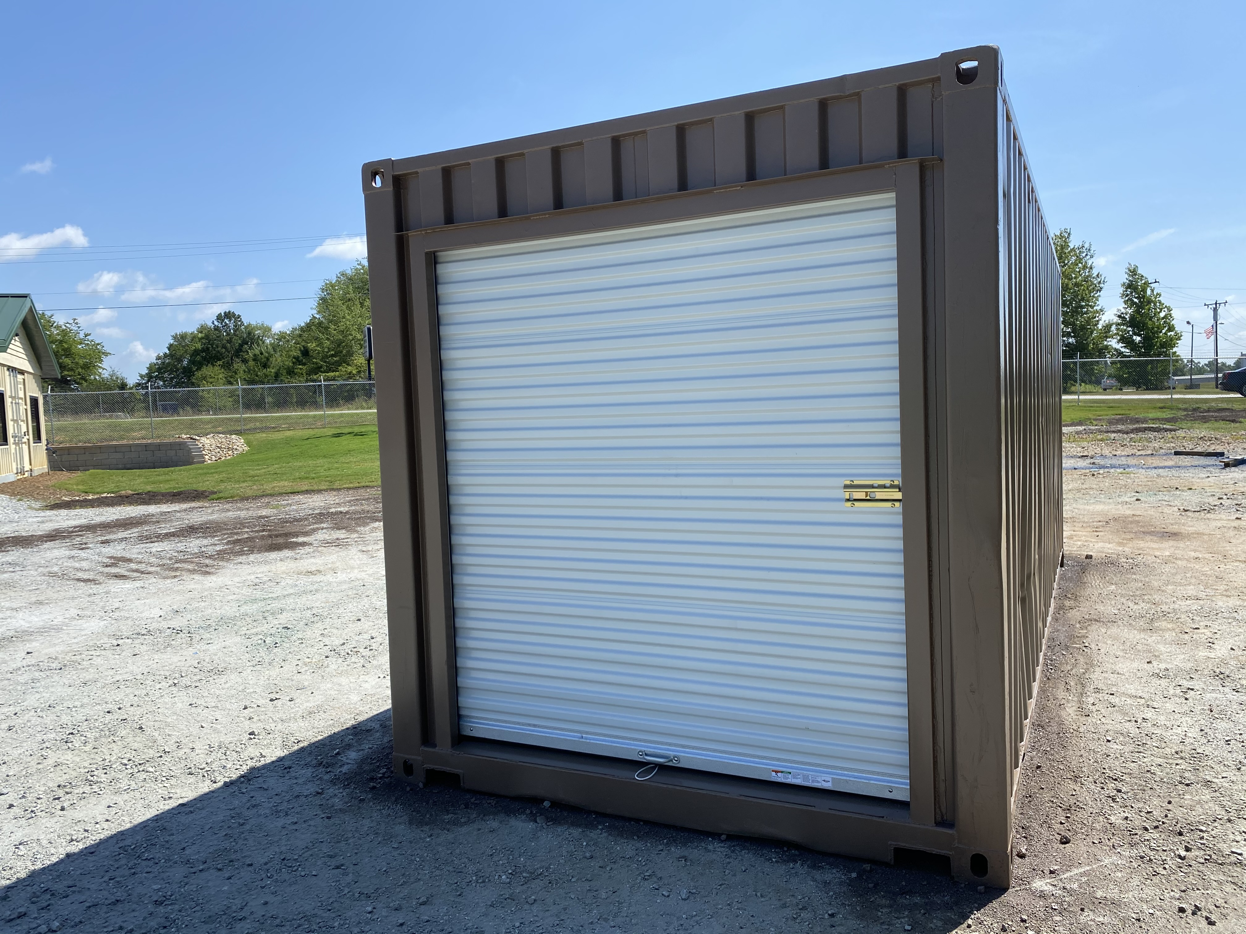 Storage container with roll up door after modification