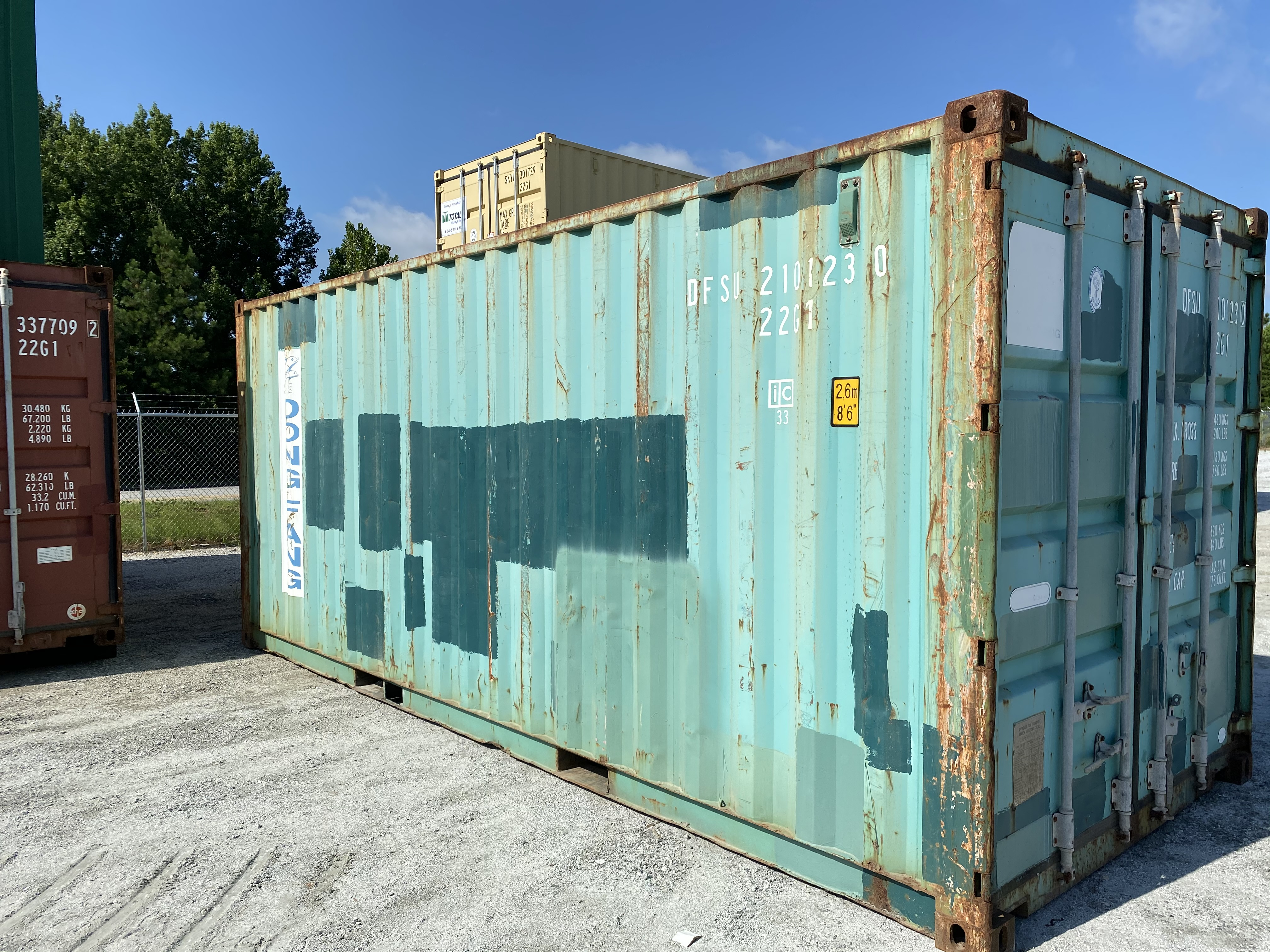 Teal storage container before modification