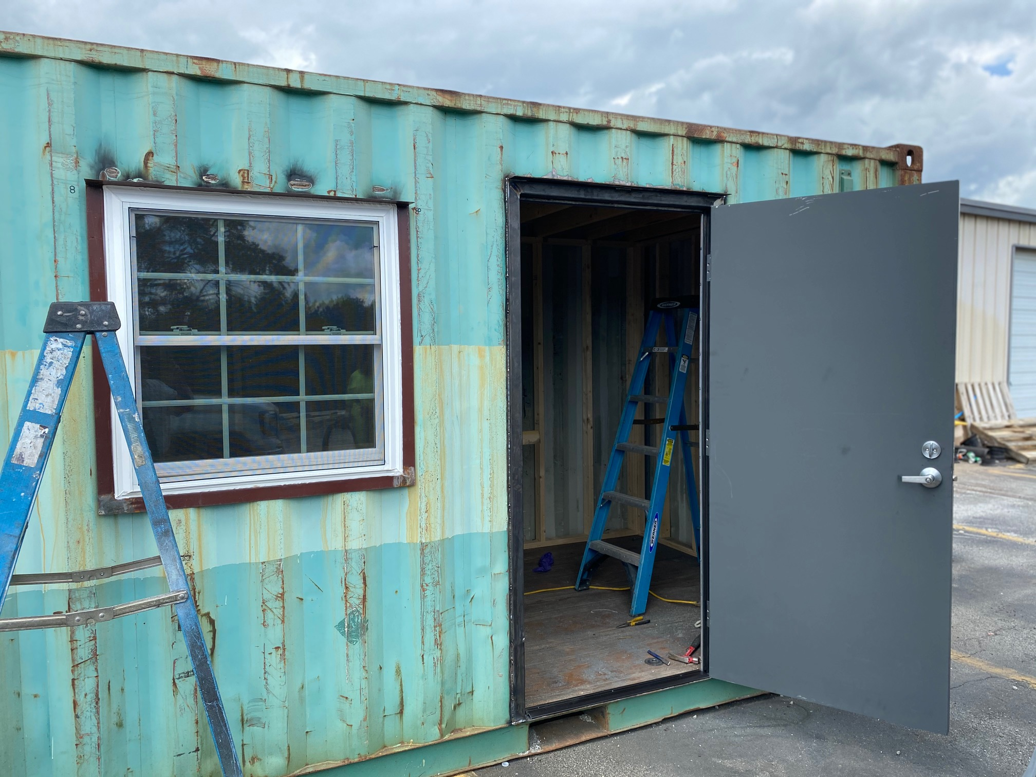 Teal storage container under construction